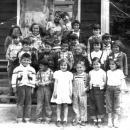 "School kids, 1st Row Left to Right: Rod Naknakim, Dennis Dick, Katherine ""Cookie"" Naknakim, Louisa Scow, Charlene Assu, Mercy Naknakim, 2nd Row Left to Right: Wayne Assu, Harry Price, Harvey/Wayne Assu, Melvin Chickite, Florence Lewis, Unknown, 3rd Row Left to Right: Johnny Moon, Unknown, Unknown, Robert Dick, Unknown, 4th Row Left to Right: Joanne Assu, June Peters, Lavina Johnson, Joan Assu, Florence Lewis, 5th Row Left to Right: Unknown, Unknown"